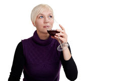 Young woman tasting red wine Royalty Free Stock Image