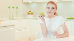Young woman tasting ripe apple stock footage