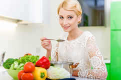 Young woman tasting soup. Healthy Vegetarian Food. Dieting Concept. Healthy Lifestyle. Cooking At Home Stock Image