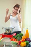 Young woman tasting soup Royalty Free Stock Photo