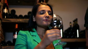 Young woman tasting in a wine cellar stock video