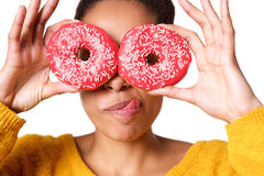 Young woman with tasty donuts Stock Photos