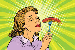 Young woman with tasty sausage. Pop art retro vector illustration. Street fast food lunch Royalty Free Stock Photos