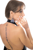 Young woman with a tattoo. On her back stock images