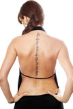 Young woman with a tattoo on her back. Isolated royalty free stock images