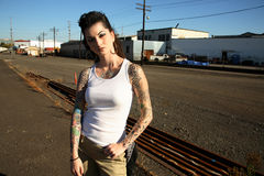 Young woman with tattoos stock image