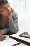 Young woman and tax form Royalty Free Stock Photo