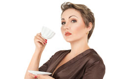 Young woman with tea Royalty Free Stock Images