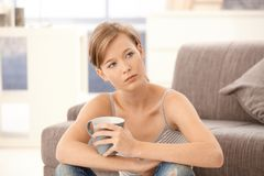 Young woman with tea Royalty Free Stock Photography