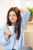 Young woman with tea cup Royalty Free Stock Photography
