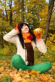 Young  woman with tea cup in the autumn park Stock Photos
