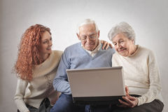 Young woman teaching how to use a laptop Royalty Free Stock Photo