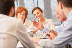 Young woman and team in consulting meeting Stock Photos