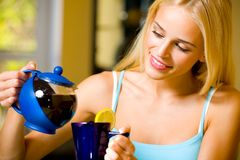 Young woman with teapot Stock Photography