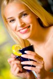 Young woman with teapot Royalty Free Stock Photo