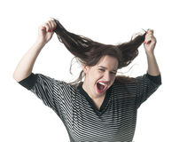 Young woman tearing her hair Royalty Free Stock Photos