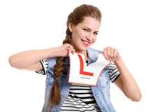 Young woman tearing learner driver sign. On white background Royalty Free Stock Photos