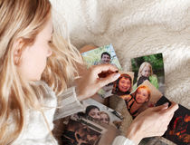Young woman, tearing photo Stock Image