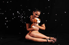 Young woman with teddy Stock Images
