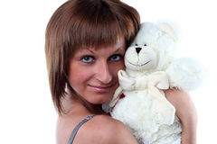 Young woman with teddy bear Royalty Free Stock Images