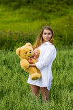 Young woman with teddy bear. Stock Images