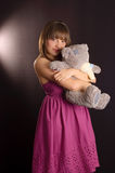 Young woman with teddy bear. Young woman in a pink dress with teddy bear Royalty Free Stock Photos