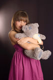 Young woman with teddy bear. Young woman in a pink dress with teddy bear Stock Images