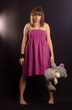 Young woman with teddy bear. Young woman in a pink dress with teddy bear Stock Photos