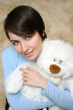 Young woman with teddy bear Royalty Free Stock Photo