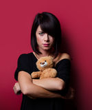 Young woman with teddy bear Royalty Free Stock Photography