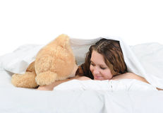 Young woman with teddybear Stock Photos