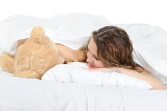 Young woman with teddybear Stock Photo
