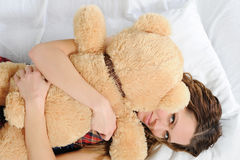 Young woman with teddybear Royalty Free Stock Photography