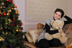 Young woman with teddybear Royalty Free Stock Images