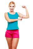 Young woman teen girl showing her muscles Stock Photography