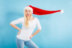 Woman wearing windblown santa hat Royalty Free Stock Photos