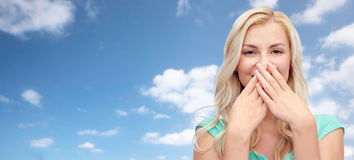 Young woman or teenage girl closing her nose Stock Photo