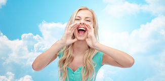 Young woman or teenage girl shouting Royalty Free Stock Photo