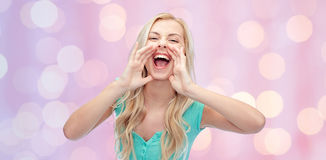 Young woman or teenage girl shouting Royalty Free Stock Image
