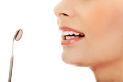 Young woman teeth and a dentist mouth mirror Royalty Free Stock Photography