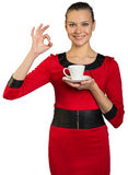 Young woman with teeth smile drinking coffee Royalty Free Stock Image