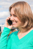 Young woman with telephone Royalty Free Stock Images