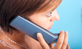 Young woman with telephone. Young woman at office with telephone Royalty Free Stock Photo