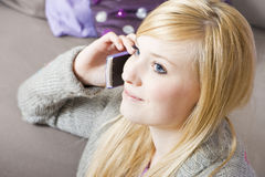 Young woman with telephone. Pretty young woman on the phone with cell phone royalty free stock images