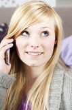 Young woman with telephone. Pretty young woman on the phone with cell phone royalty free stock photo