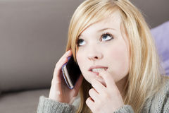 Young woman with telephone. Pretty young woman on the phone with cell phone stock photo