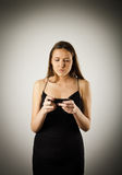 Young woman with telephone Royalty Free Stock Image