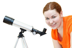 Young woman and telescope Royalty Free Stock Photo