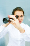 Young Woman with Telescope Stock Image