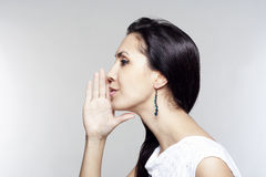 Young woman telling gossip Stock Image